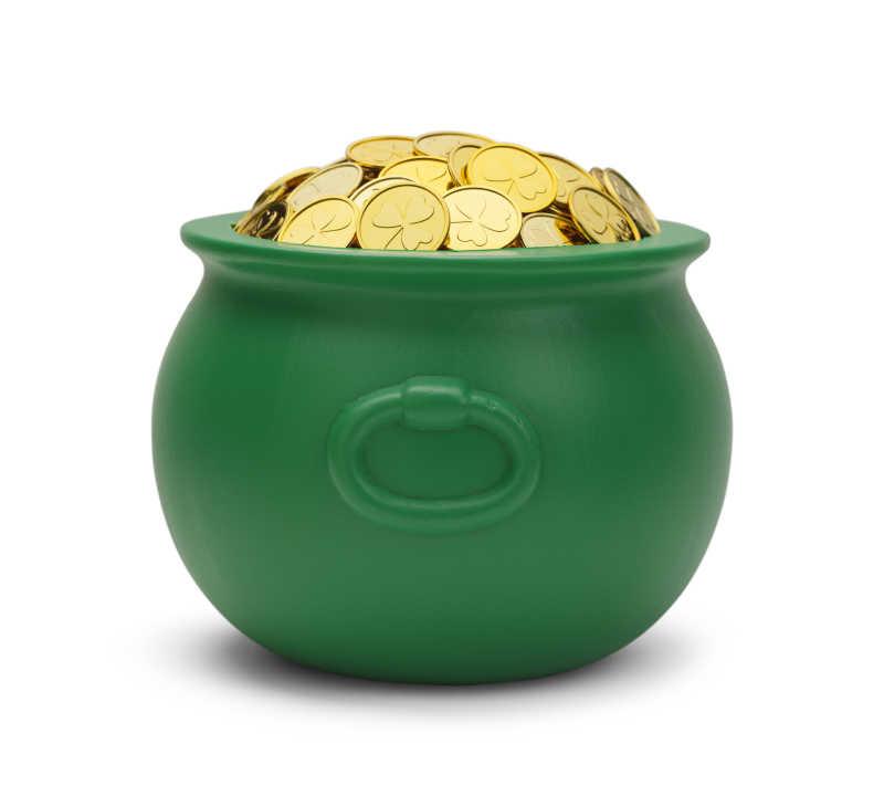 绿色盆栽与金黄金币孤立在白色背景