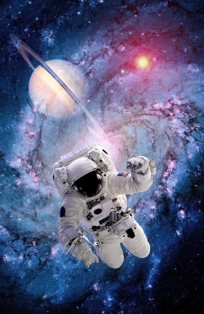 太空中的宇航员图片素材_在阳光照射下的宇宙中行走的