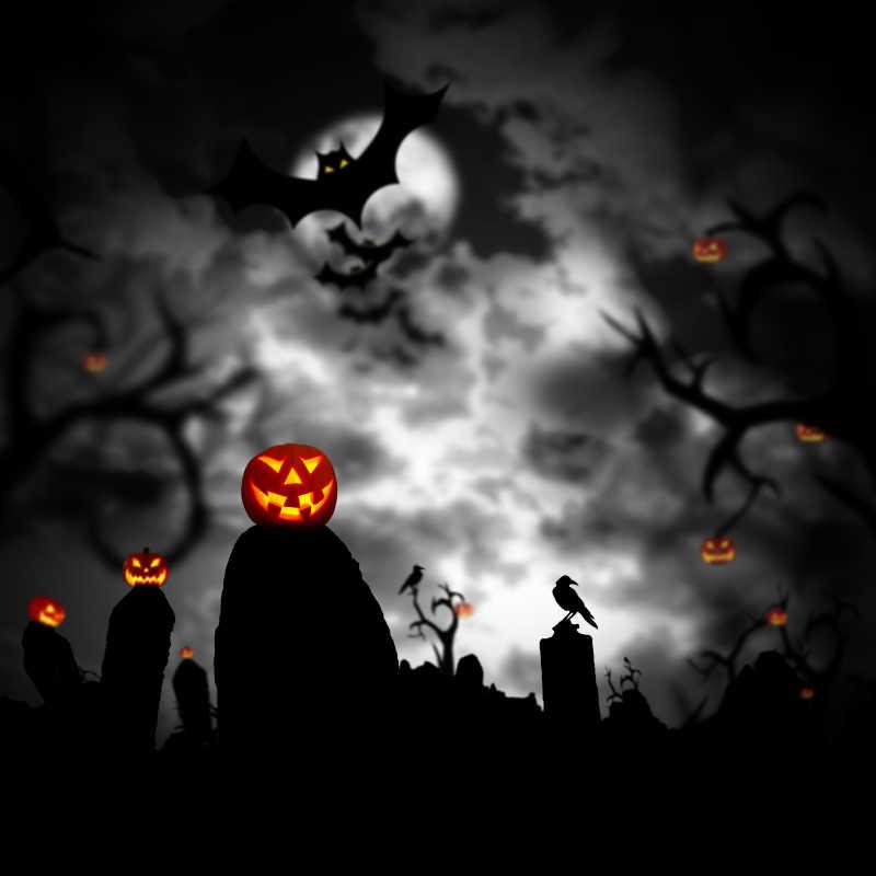 黑暗墓地里发光的南瓜灯