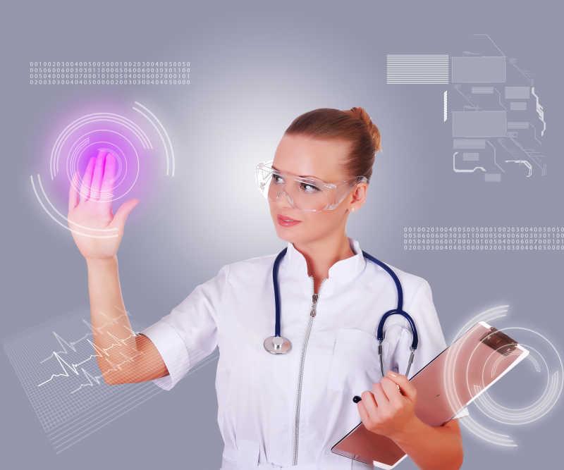 操作虚拟界面的年轻护士