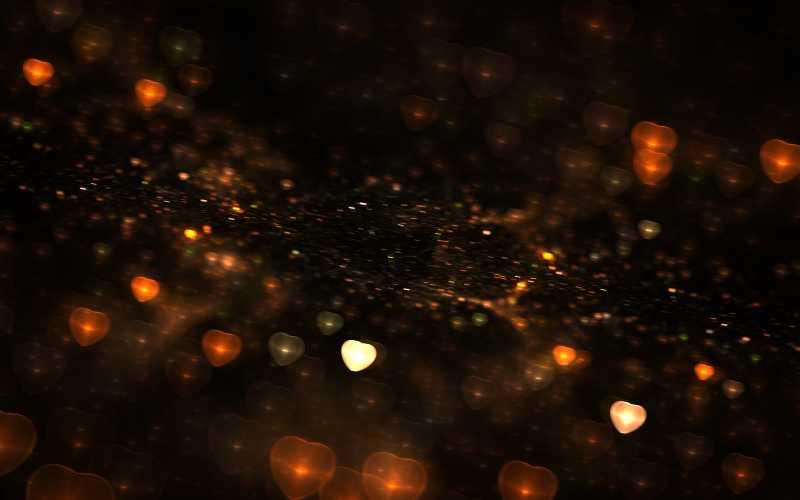 美丽的光晕背景图片素材_黑色背景上闪烁这七彩光晕