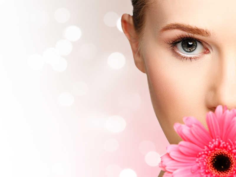 粉色非洲菊女孩半张脸肖像