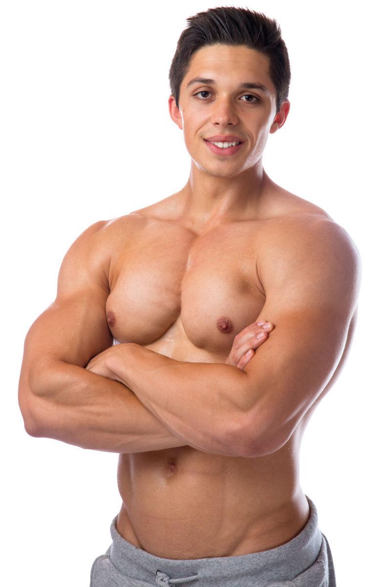 强壮的帅哥图片素材_开心的健身帅哥拿着手机照片_jpg