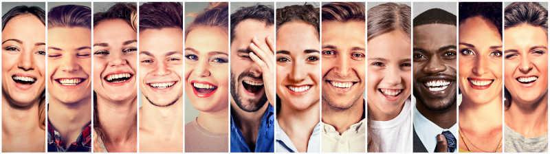 一组快乐大笑的不同国家的人脸组合