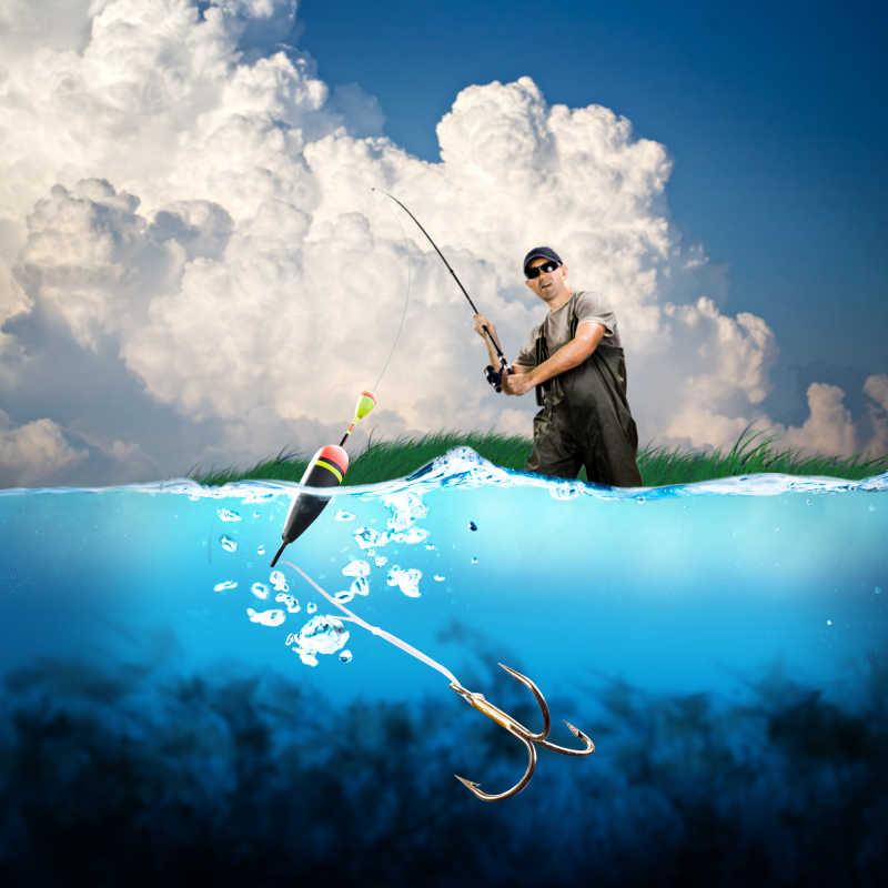 男人在拿着鱼竿海边钓鱼