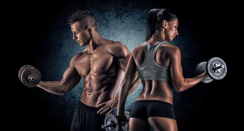 男人和女人用哑铃运动