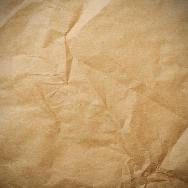 棕色皱巴巴的纸片纹理特写