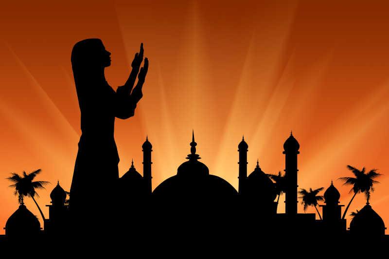 日落时分市政厅背景下的祈祷妇女图片