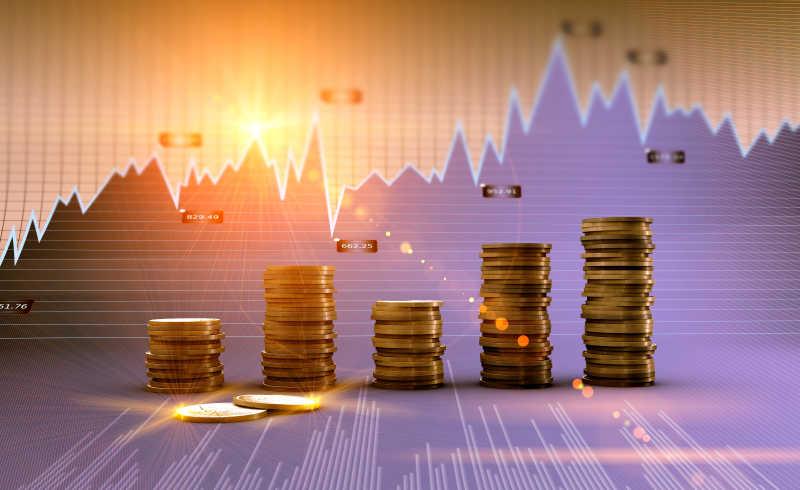财务和业务图表背景下罗列整齐的硬币
