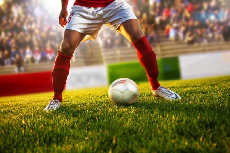 穿着红色袜子的足球运动员