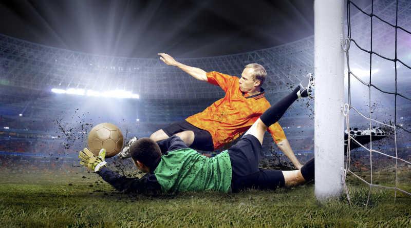 足球运动员与守门员在赛场上的跳跃