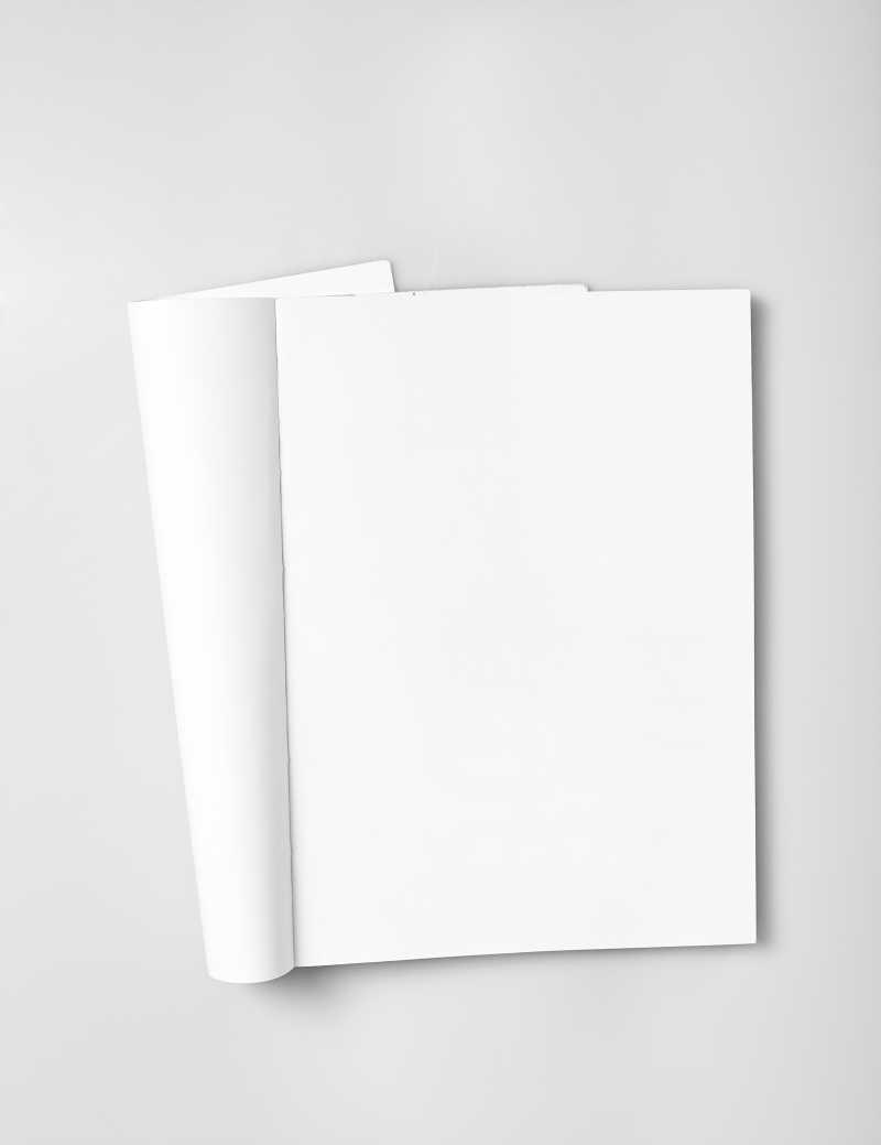 灰白色背景下打开的空白日记本