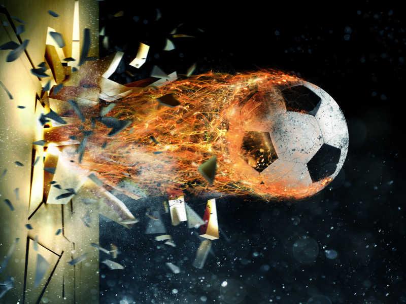 带着火焰的足球穿透墙壁