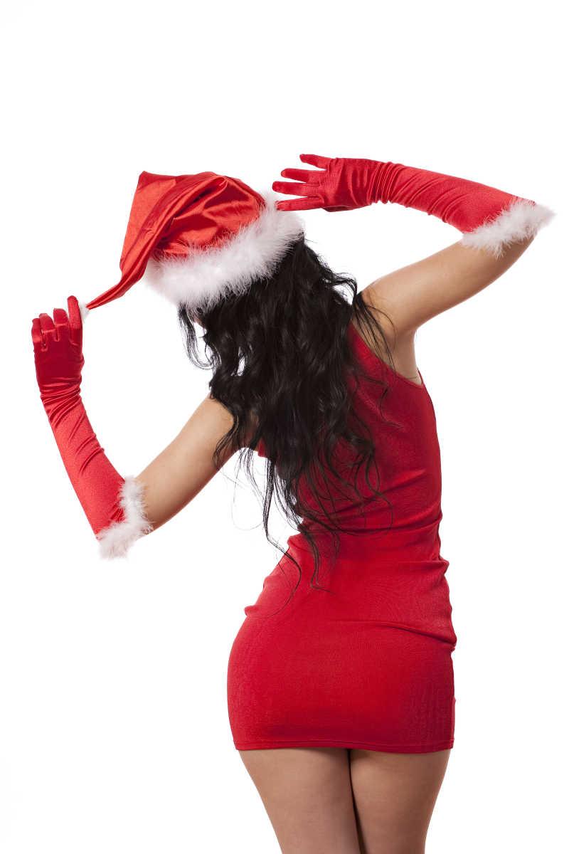 手揪着圣诞帽的性感美女