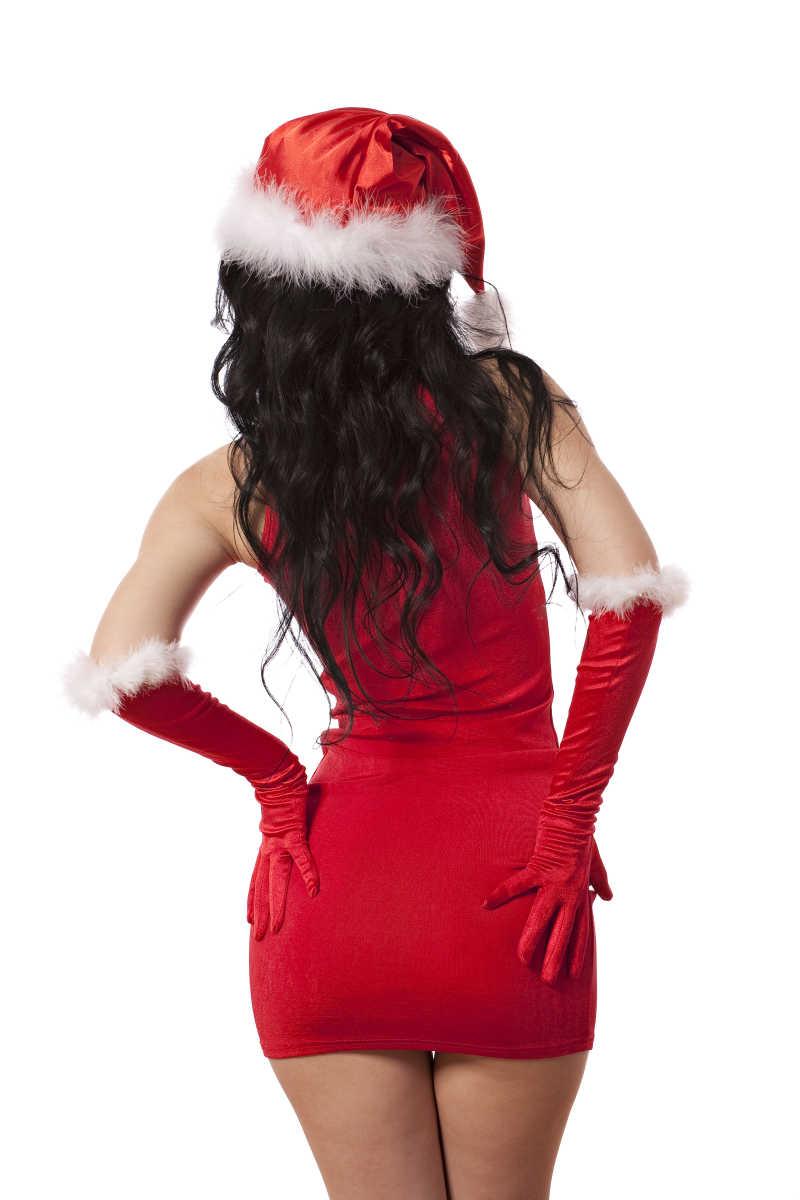白色背景下性感的圣诞老人的手放在臀部