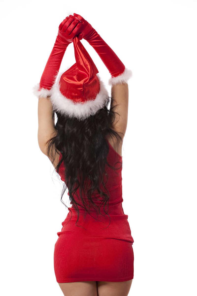白色背景下性感的女性圣诞老人背影