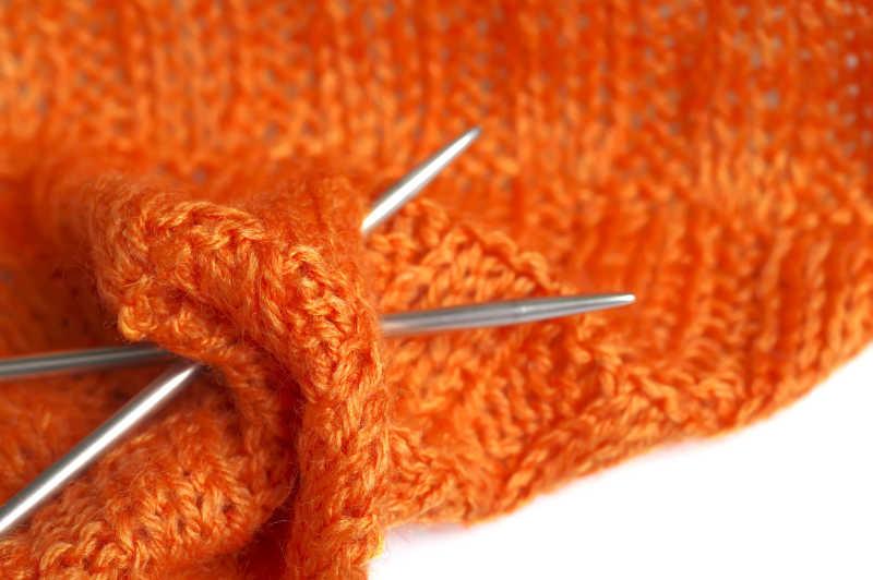 针织作品橙色纱缝线宏