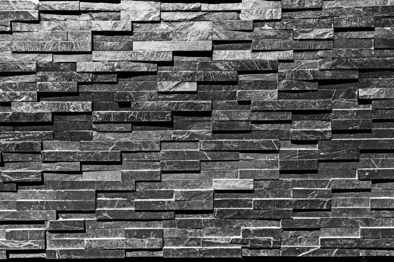 黑色砖石墙面背景