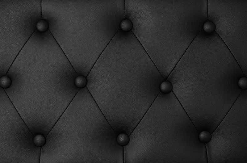 黑色纽扣装饰皮革背景