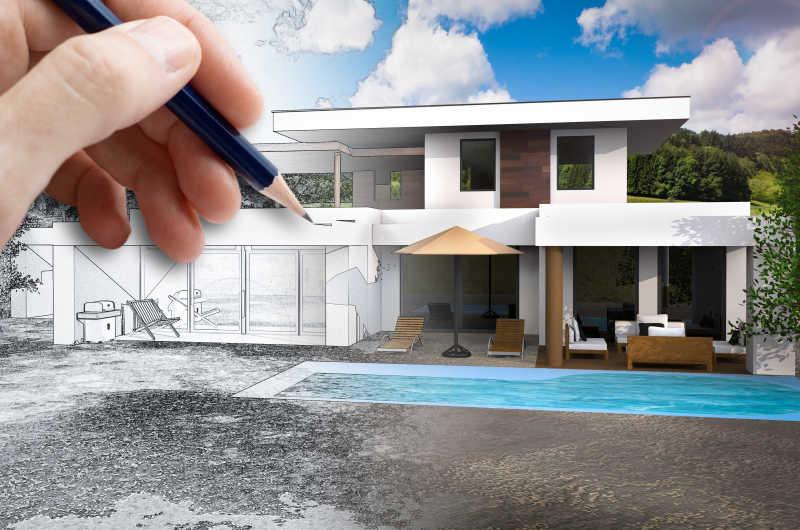 拿着笔在画房子