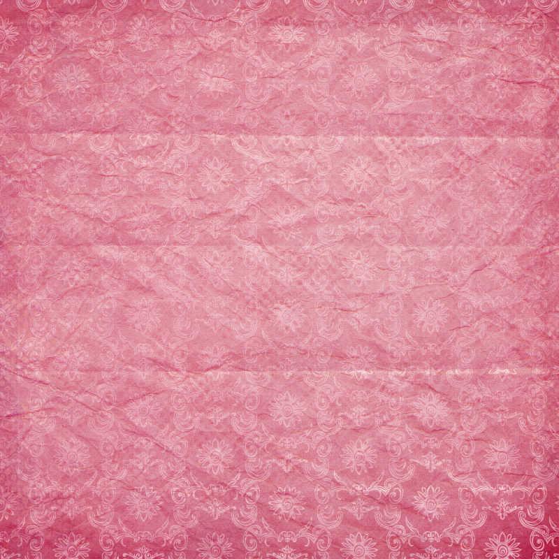 有暗纹纹理的粉红色背景
