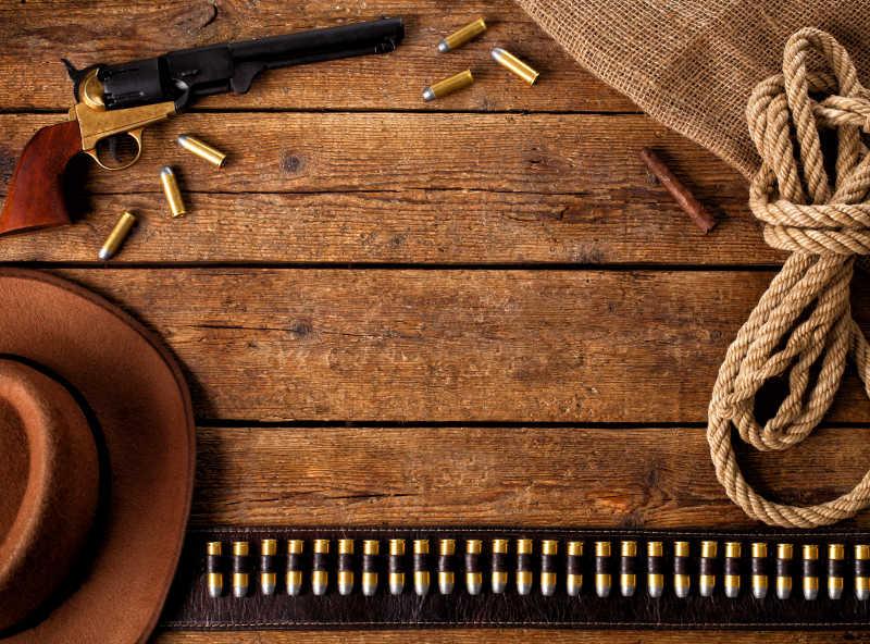 西部牛仔的帽子吉他套绳还有手枪