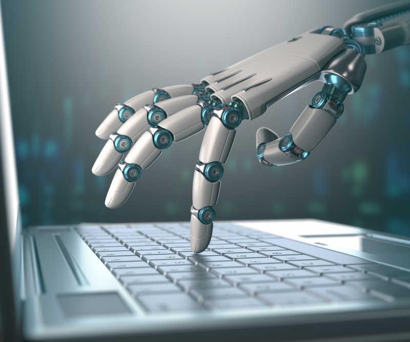 机器人手在按笔记本电脑键盘