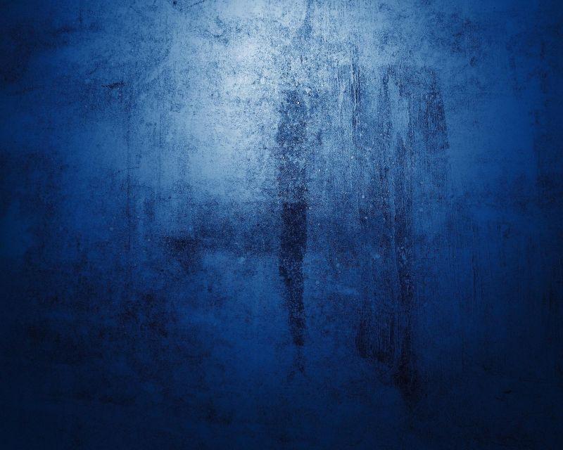 陈旧蓝色墙壁背景