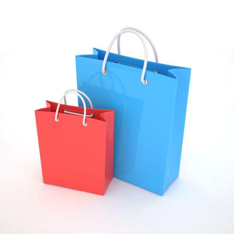 白色背景下不同大小的红色和蓝色的纸质购物袋