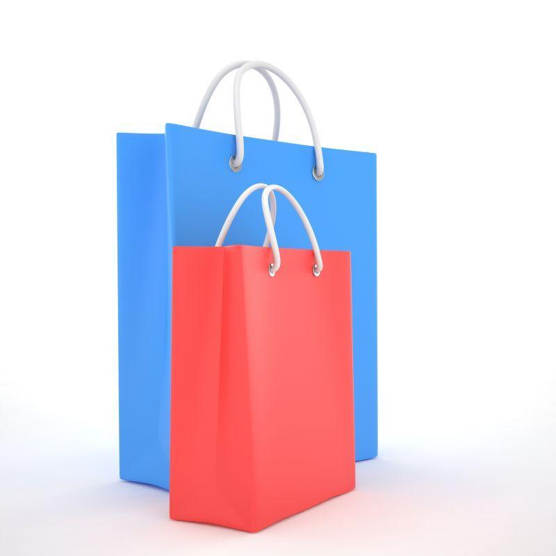 白色背景下不同颜色和大小的纸质购物袋