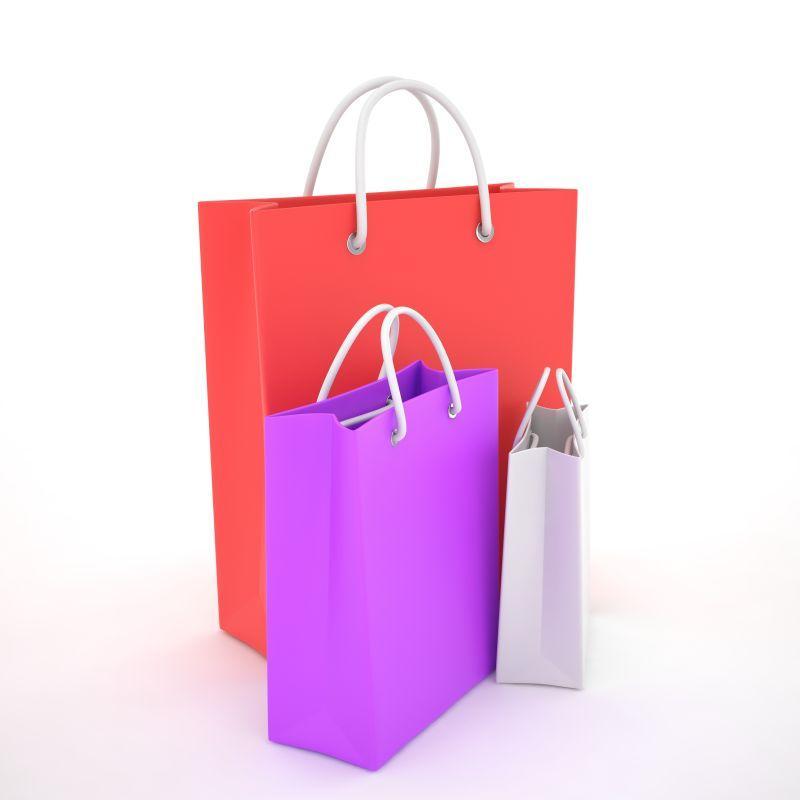 白色背景上的彩色纸质购物袋
