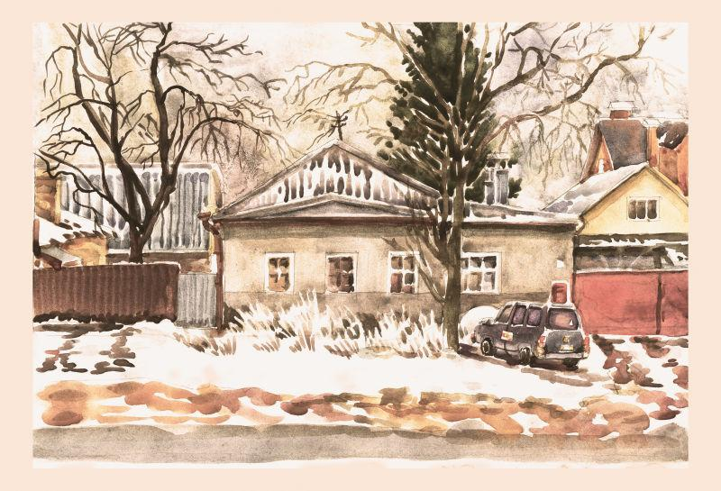 冬季城市的房屋和汽车