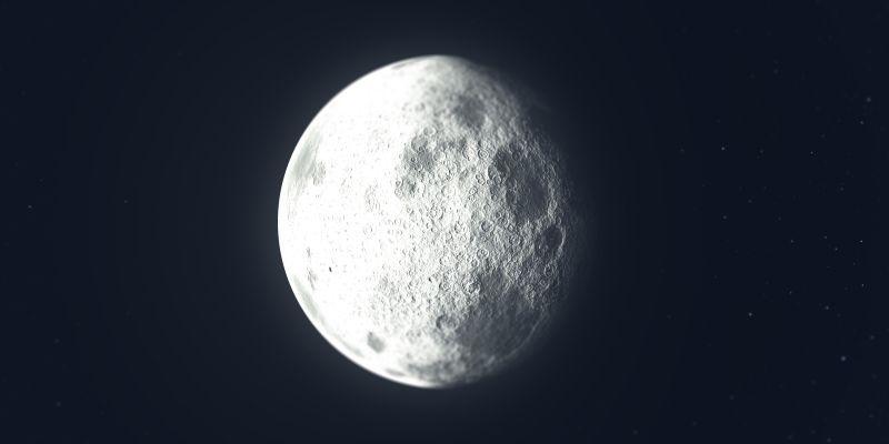 黑色背景前凸起的月亮
