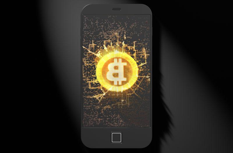 黑色背景前手机中的比特币封面