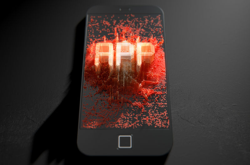 黑色背景前的手机APP显示