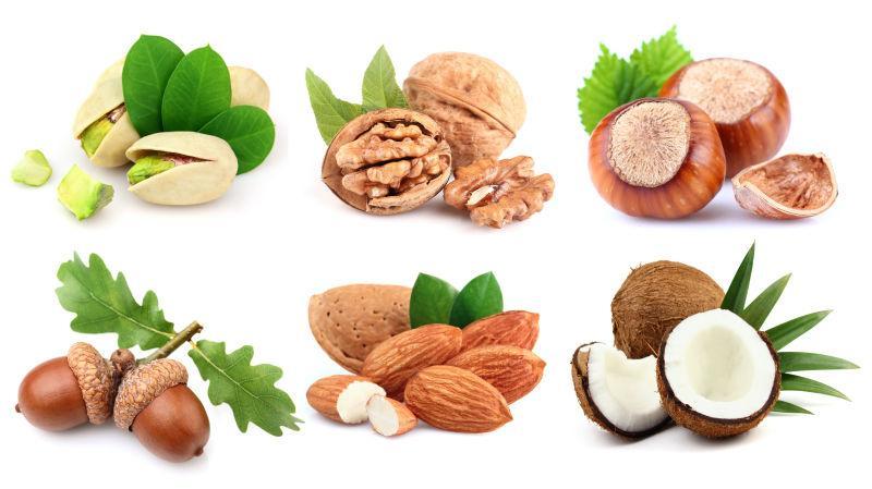 白色背景上不同的六种美味坚果