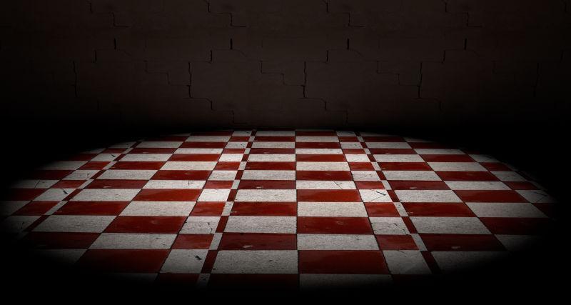 水泥地面上的红白格子图案