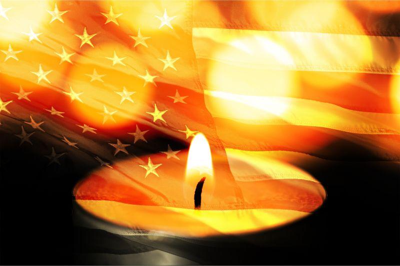 美国国旗映衬下的油灯