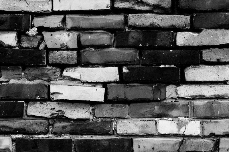 有裂缝的砖墙纹理背景