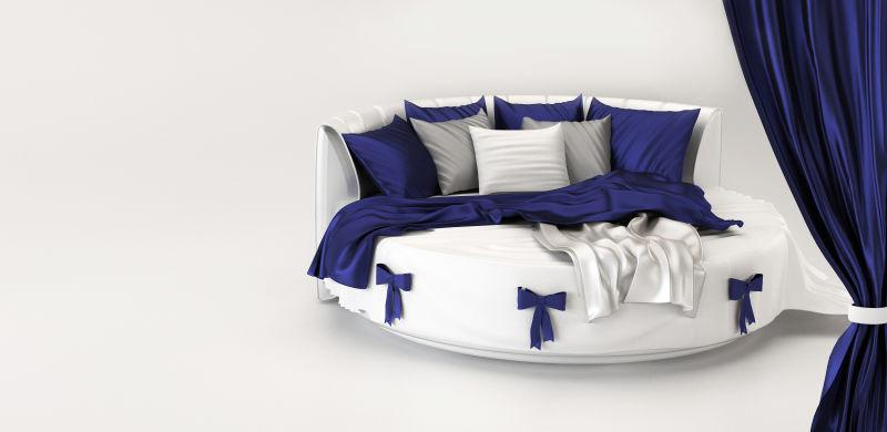 白色卧室内蓝白色的圆形床