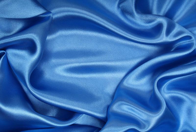 平滑飘逸的蓝色丝绸背景