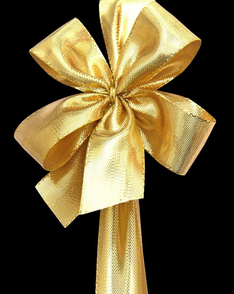 黑色背景上的金色蝴蝶结