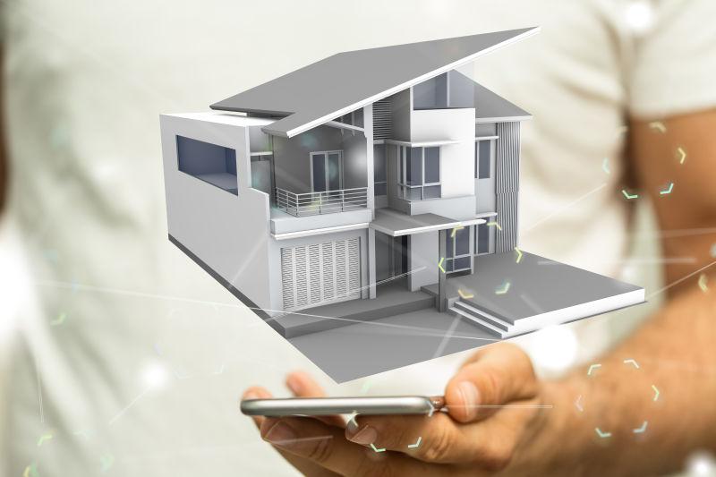 商人拿着手机看房子