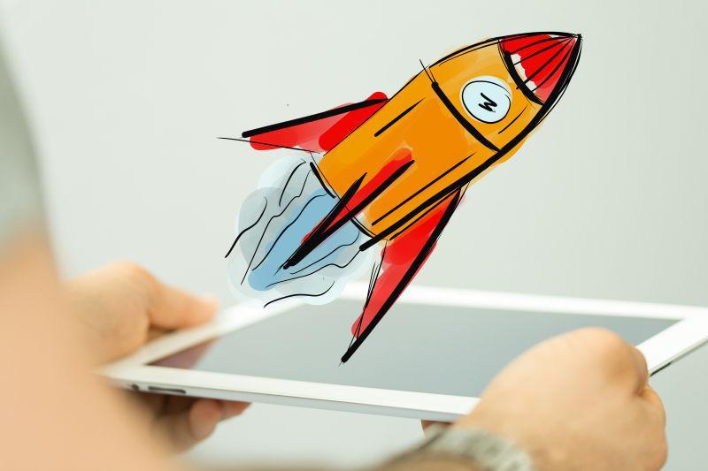 平板上发射的卡通火箭
