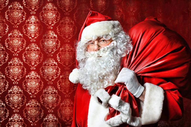 圣诞老人的画像和一袋礼物