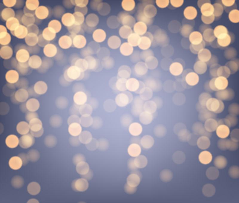矢量的金色光斑背景设计