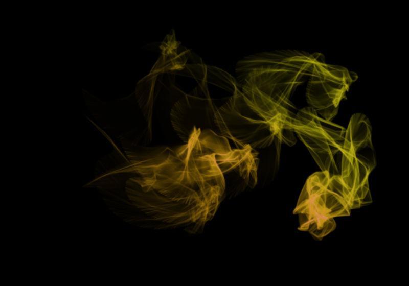 黑色背景上黄色透明烟雾