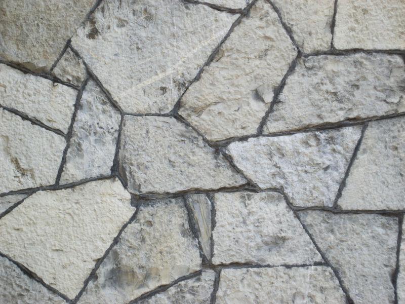 菱角分明的碎石头石墙背景