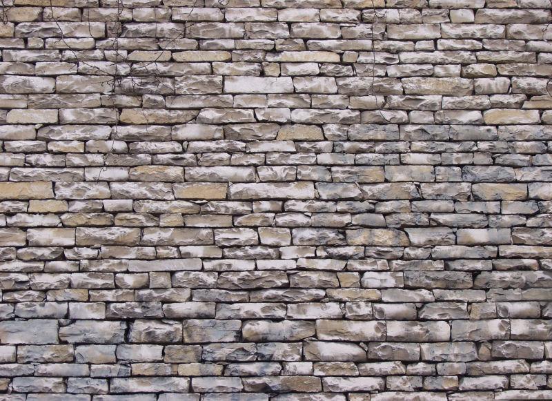 发白石头墙背景