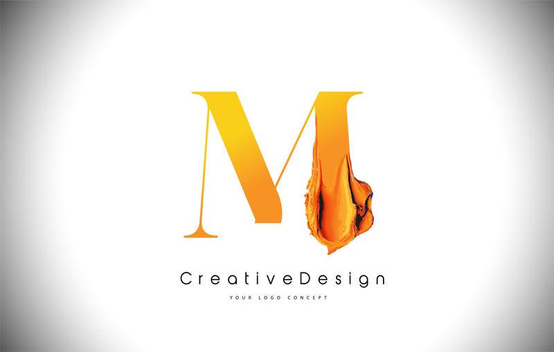 M橙色字母设计刷油漆笔画金黄色M字母